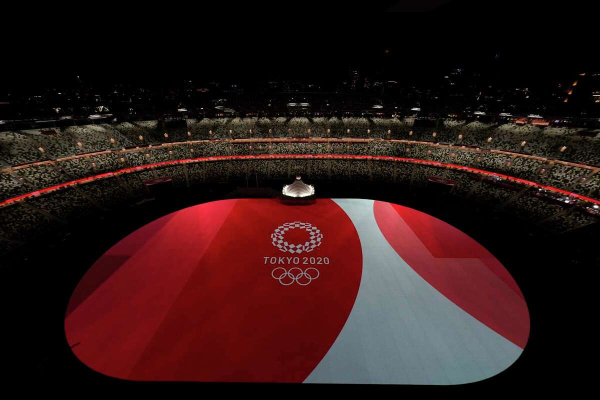 The floor of Olympic Stadium is lit before the start of the opening ceremony at the 2020 Summer Olympics, Friday, July 23, 2021, in Tokyo.