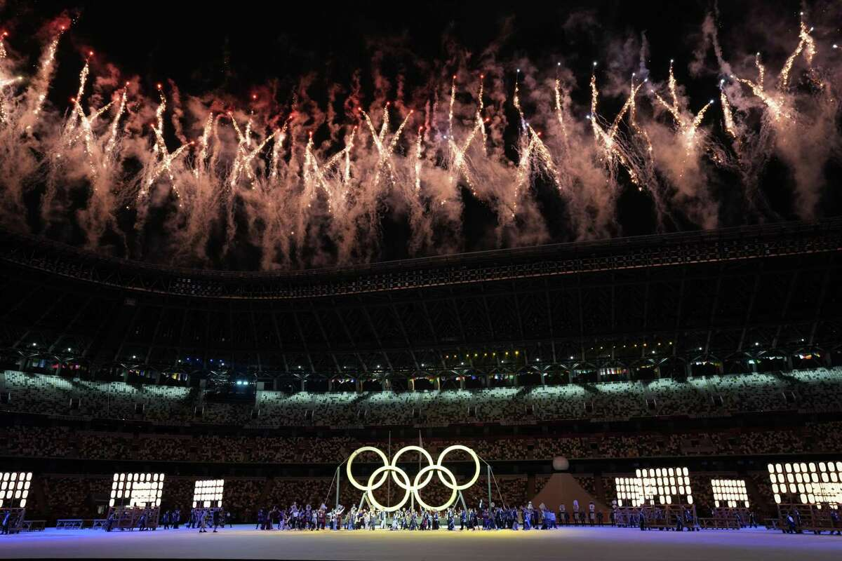 Fireworks over the Olympic Stadium during the opening ceremony of the postponed 2020 Tokyo Olympics in Tokyo on Friday, July 23, 2021.