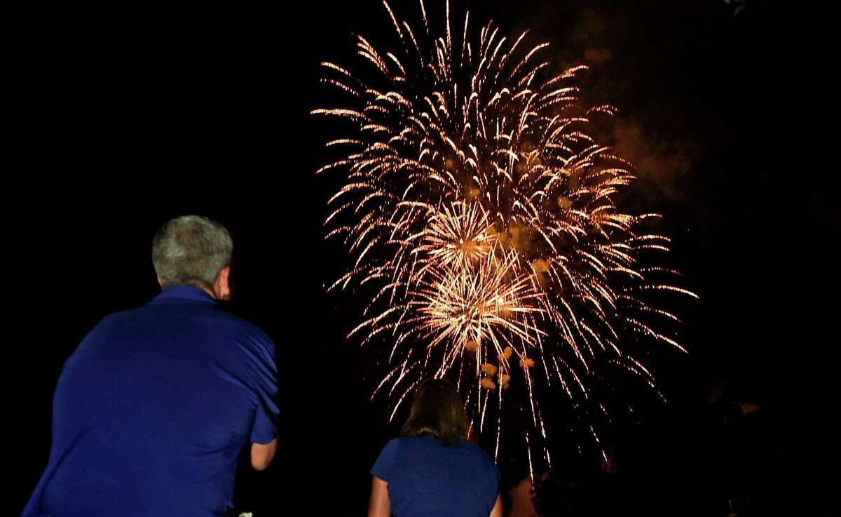 Residents enjoy the Darien 2021 Fireworks Display at Darien High School Thursday, July 23, 2021, in Darien, Conn. Last year's display was cancelled due to the pandemic.