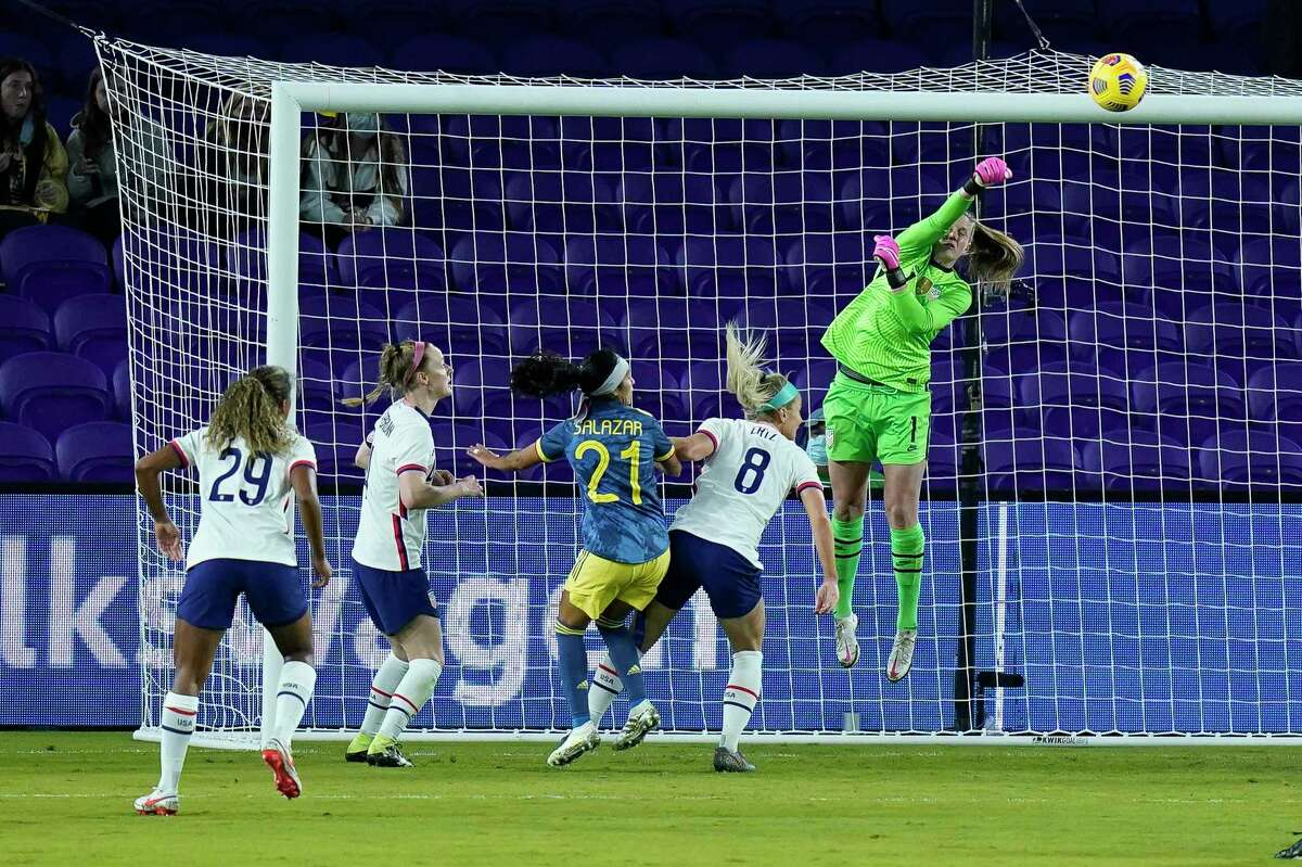 United States goalkeeper Alyssa Naeher, right, blocks a shot off a corner kick by Colombia defender Sofia Garcia during the second half of an international friendly in January in Orlando, Fla.