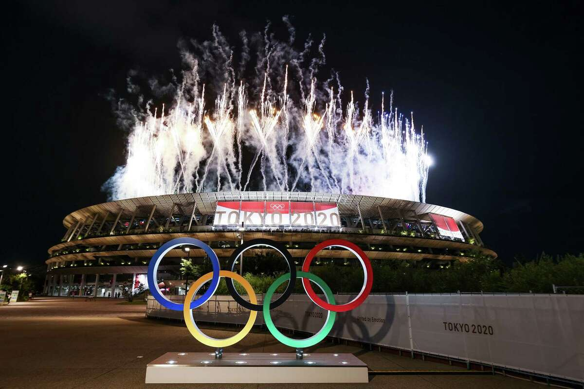 TOKYO, JAPAN - JULY 23: A general view outside the stadium as fireworks are let off during the Opening Ceremony of the Tokyo 2020 Olympic Games at Olympic Stadium on July 23, 2021 in Tokyo, Japan.