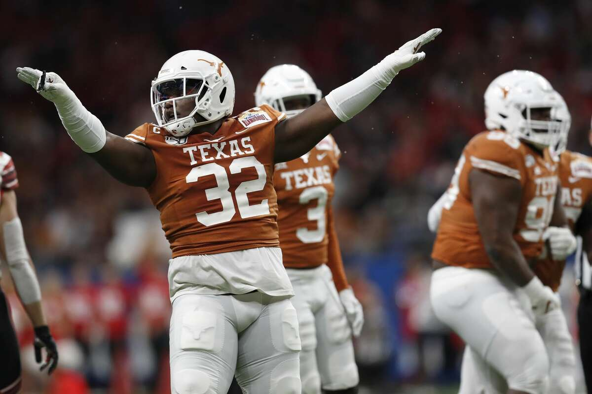 Malcolm Roach (32) of the Texas Longhorns celebrates a tackle in the second quarter against the Utah Utes during the Valero Alamo Bowl at the Alamodome on December 31, 2019 in San Antonio, Texas.