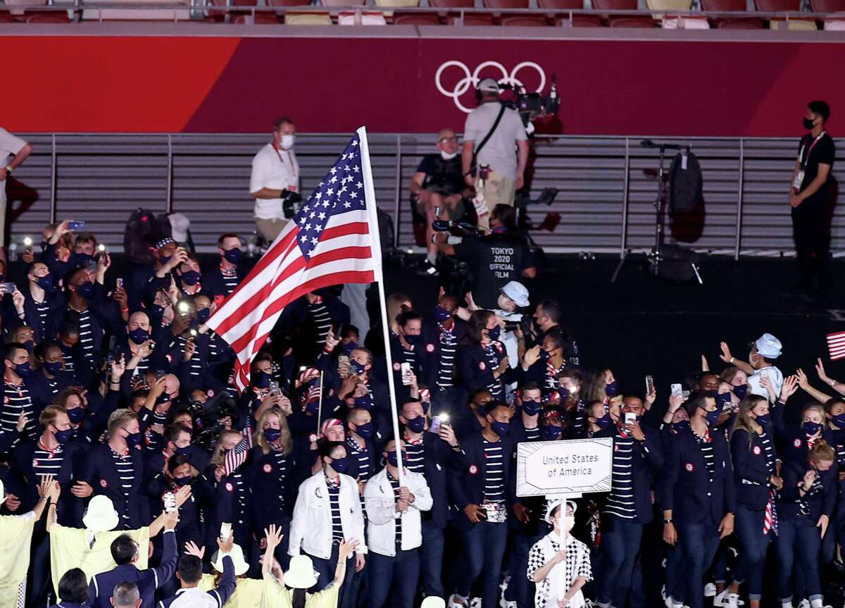 TOKYO, JAPAN - JULY 23: Flag bearers Sue Bird and Eddy Alvares of Team United States lead their team out during the Opening Ceremony of the Tokyo 2020 Olympic Games at Olympic Stadium on July 23, 2021 in Tokyo, Japan. (Photo by Maja Hitij/Getty Images)