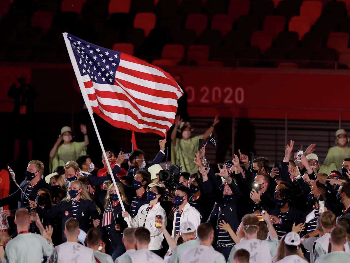 Flag bearers Sue Bird and Eddy Alvares of Team United States lead their team out during the Opening Ceremony of the Tokyo 2020 Olympic Games at Olympic Stadium on July 23, 2021 in Tokyo, Japan.