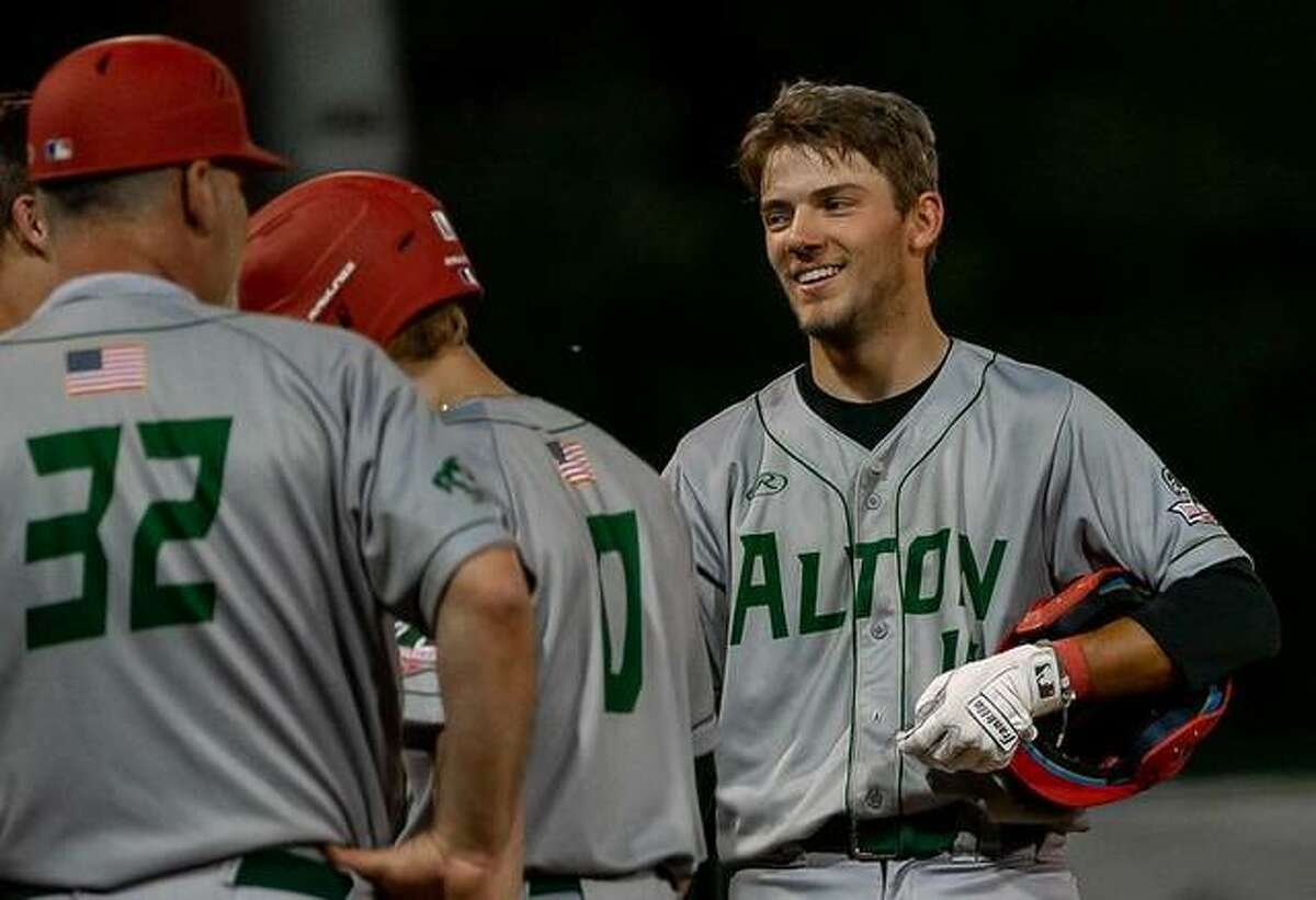 Bryce Zupan, right, had two hits and three RBIs for the Alton River Dragons Thursday night in a 9-5 victory over the Springfield Sliders in Prospect League action at Lloyd Hopkins Field.
