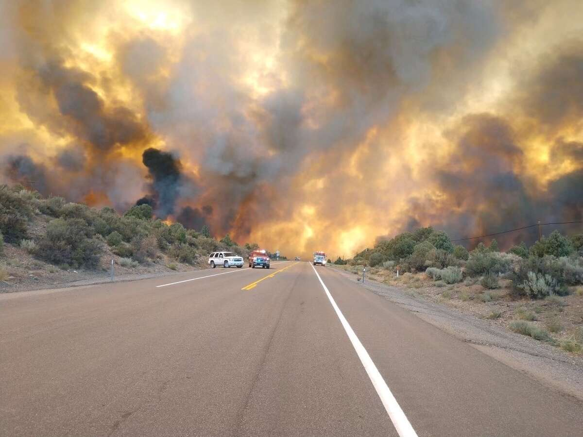 A spot fire from the Tamarack Fire in Nevada and California crossed Highway 395 Thursday and grew rapidly on July 22, 2021.