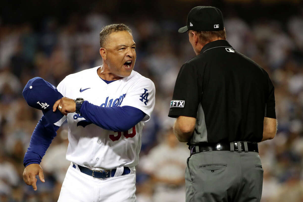 Manager Dave Roberts of the Los Angeles Dodgers reacts after first base umpire Ed Hickox made the call on a no-swing for a walk to Darin Ruf of the San Francisco Giants to tie the game 3-3 in the ninth inning at Dodger Stadium on July 22, 2021.