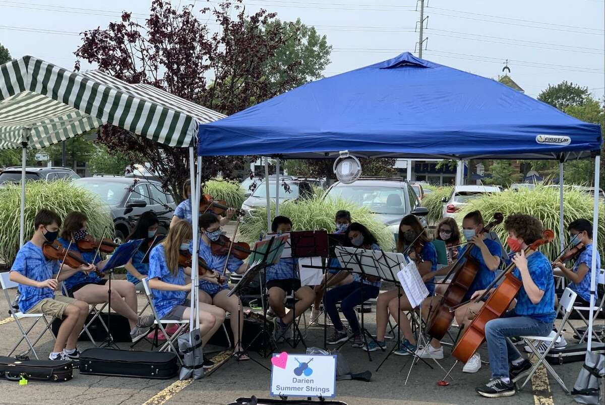 The Darien Summer Strings group of musicians recently treated shoppers to a concert of familiar favorite songs on Wednesday, July 24, at the Darien Farmers Market in the Goodwives Shopping Center in the town.
