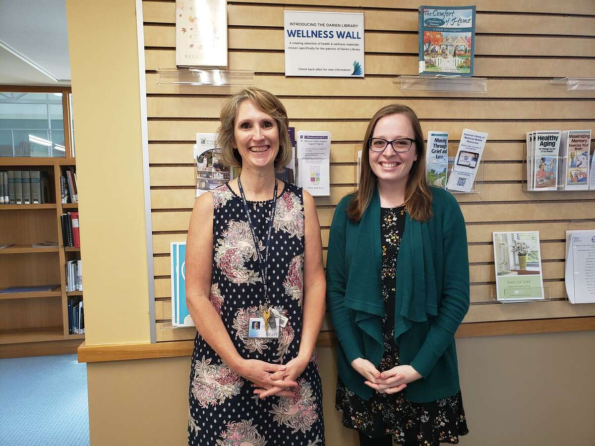 """Darien Library Knowledge and Learning Services Librarian Colleen Wood, and Darien Library Head of Knowledge and Learning Services Librarian Brittany Netherton, are pictured at the library in the town in a previous year. The library previously started a new, and free program called Caregiver Cafe, which provides respite to caregivers. The caregivers can bring the person, who is in their care, with them to the library. Many people experience a connection to the dead that can only be described as a haunting. """"In Healing and Hauntings,"""" the library is presenting an opportunity for attendees to share their experiences with the dead on Wednesday, August 4, at 7 p.m."""