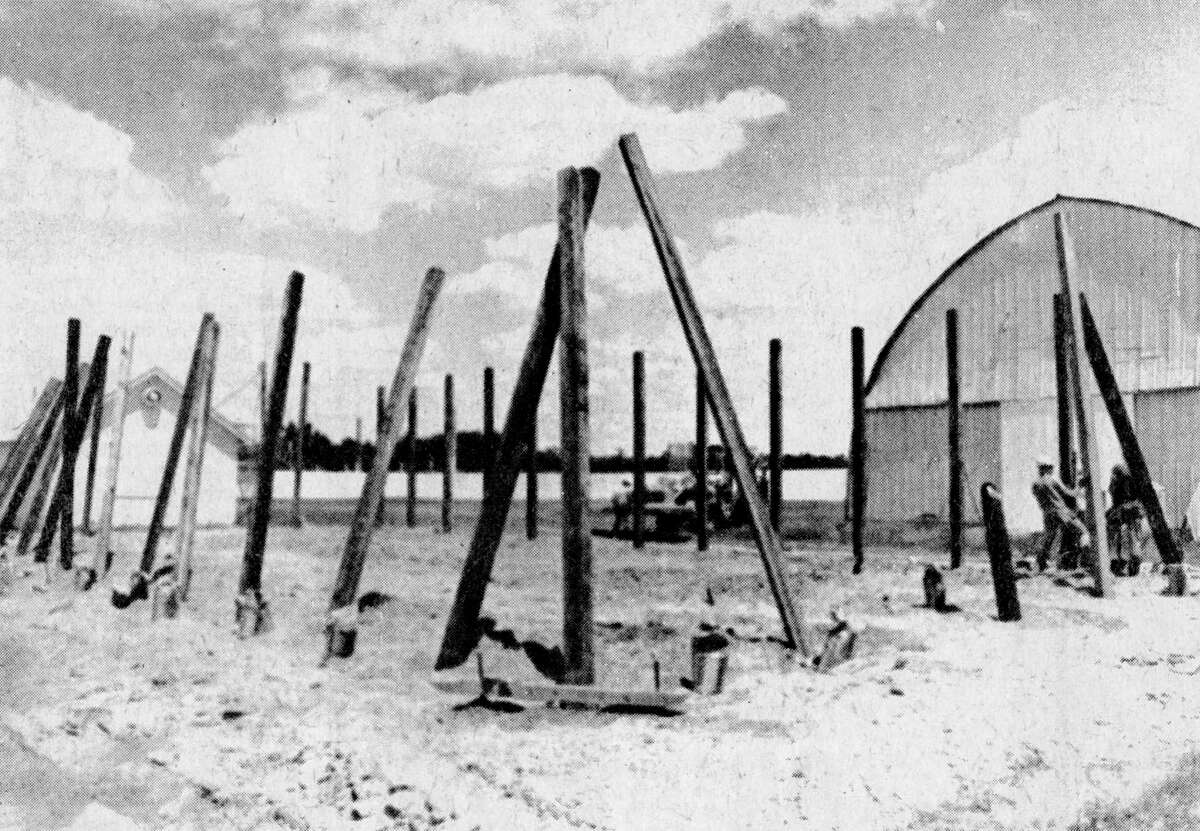 At the moment, all it looks like is a bunch of poles stuck into the ground, but soon it will be the new 4-H livestock building at the Manistee County Fairgrounds. The construction company is from Kalkaska. The photo was published in News Advocate on July 23, 1981. (Manistee County Historical Museum photo)