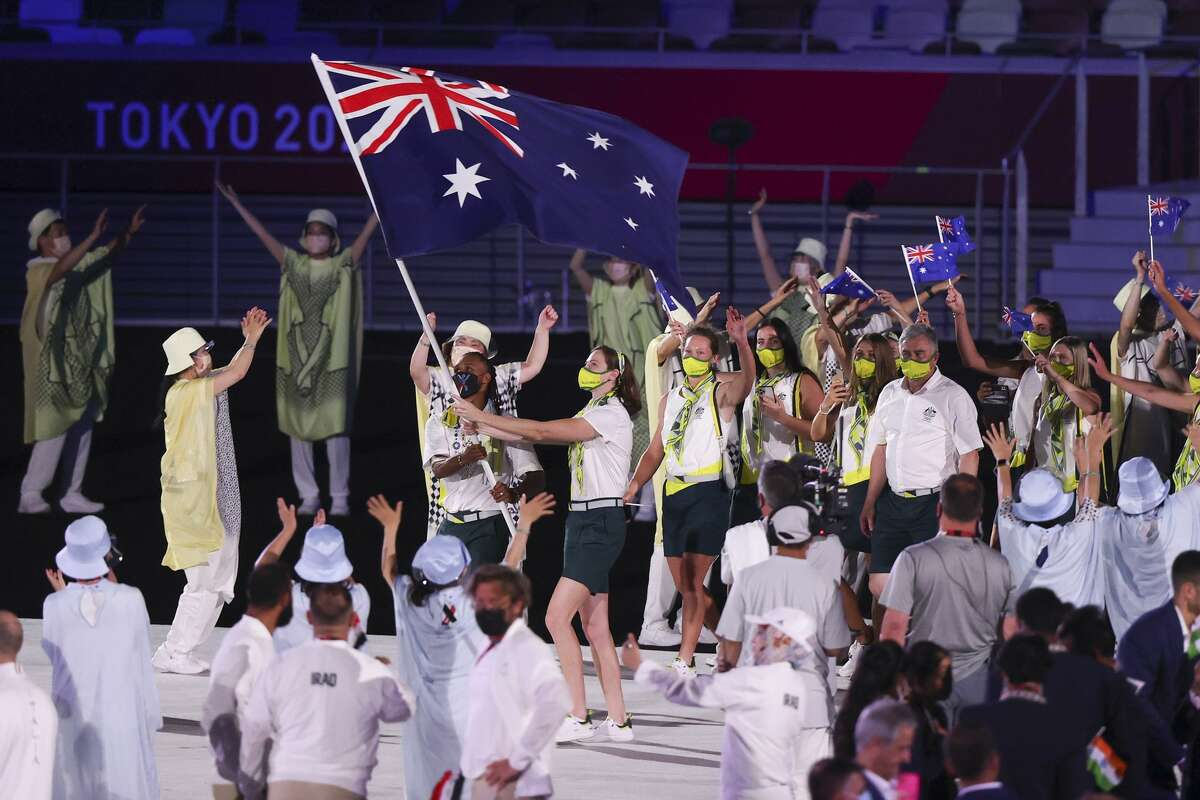 TOKYO, JAPAN - JULY 23: Team Australia flag bearers Cate Campbell and Patty Mills lead their team during the Tokyo 2020 Olympic Games Opening Ceremony at Olympic Stadium on July 23, 2021 in Tokyo, Japan.  (Photo by Clive Rose / Getty Images)