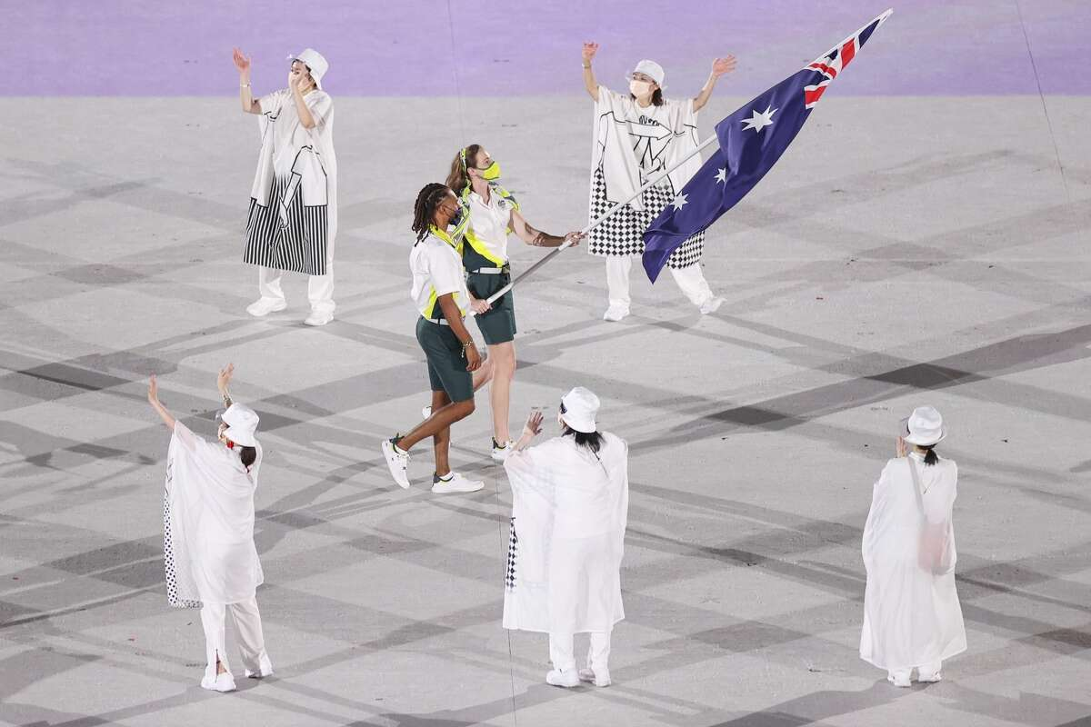 TOKYO, JAPAN - JULY 23: Team Australia flag bearers Cate Campbell and Patty Mills lead their team during the Tokyo 2020 Olympic Games Opening Ceremony at Olympic Stadium on July 23, 2021 in Tokyo, Japan.  (Photo by Cameron Spencer / Getty Images)
