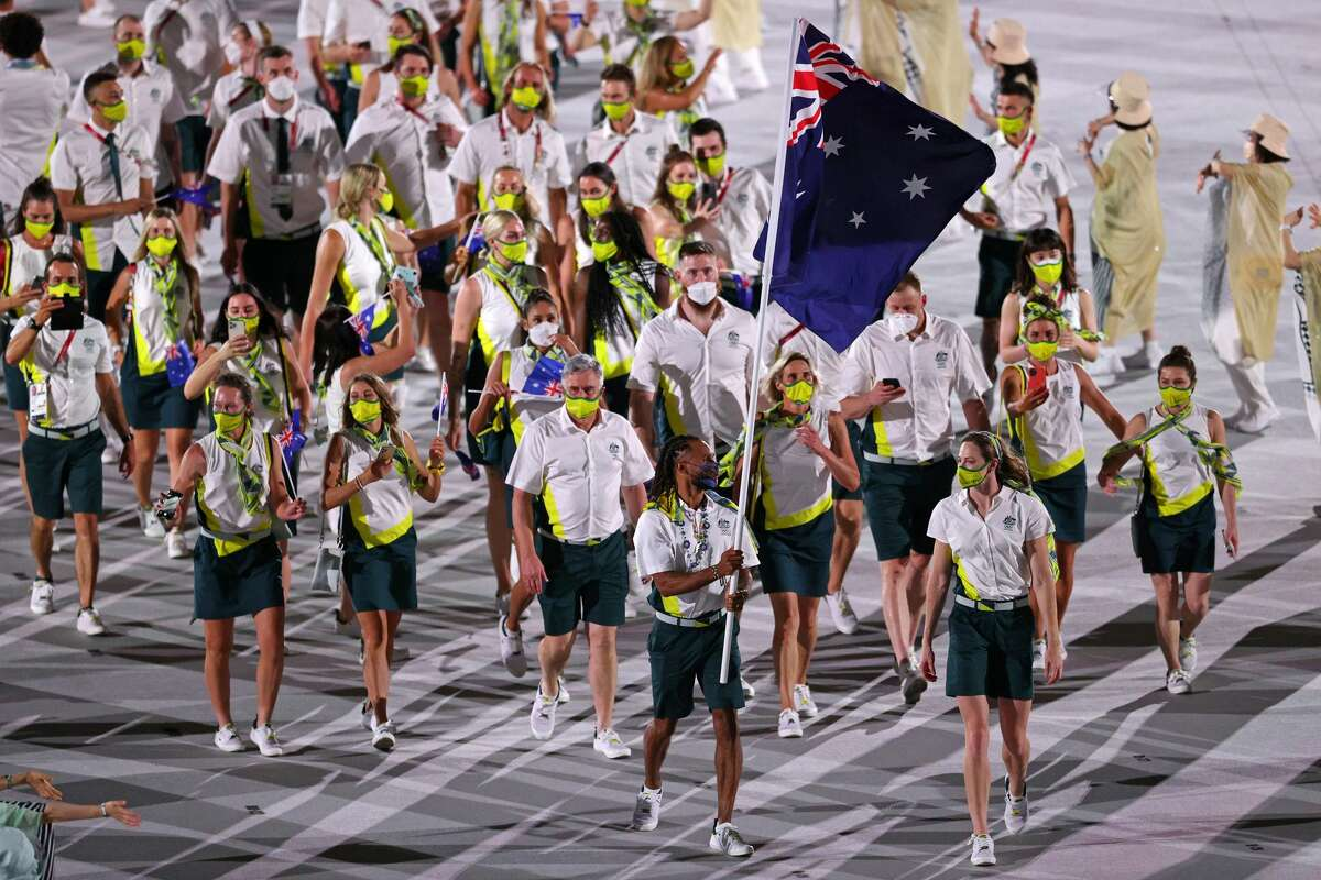 TOKYO, JAPAN - JULY 23: Flag bearers Cate Campbell and Patty Mills of Team Australia lead their team during the Opening Ceremony of the Tokyo 2020 Olympic Games at Olympic Stadium on July 23, 2021 in Tokyo, Japan. (Photo by Patrick Smith/Getty Images)