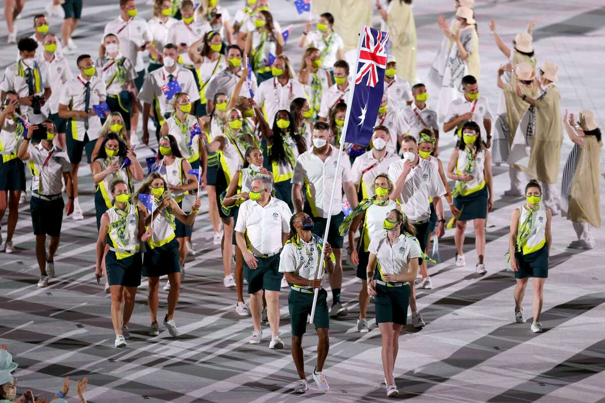 TOKYO, JAPAN - JULY 23: Team Australia flag bearers Cate Campbell and Patty Mills lead their team during the Tokyo 2020 Olympic Games Opening Ceremony at Olympic Stadium on July 23, 2021 in Tokyo, Japan.  (Photo by Patrick Smith / Getty Images)