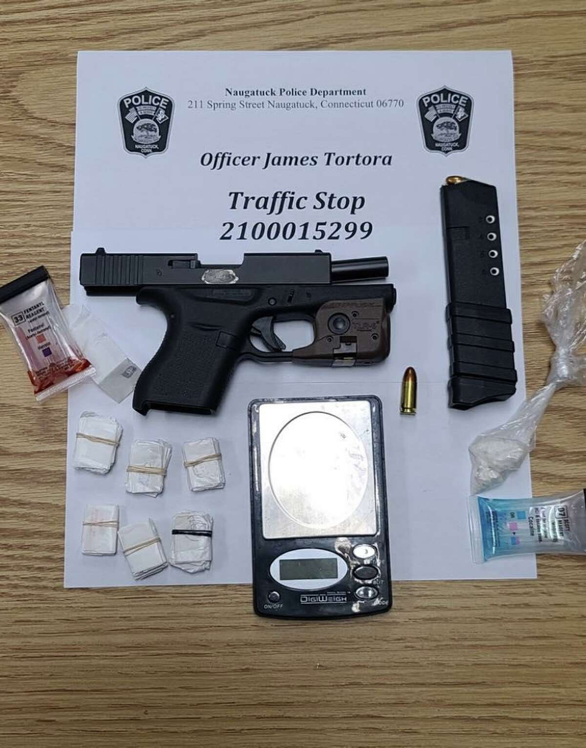 Police said investigators found a Glock pistol with an obliterated serial number, 56 bags of fentanyl and 7.2 grams of crack cocaine in an abandoned vehicle in Waterbury, Conn., after the vehicle fled a traffic stop in Naugatuck.