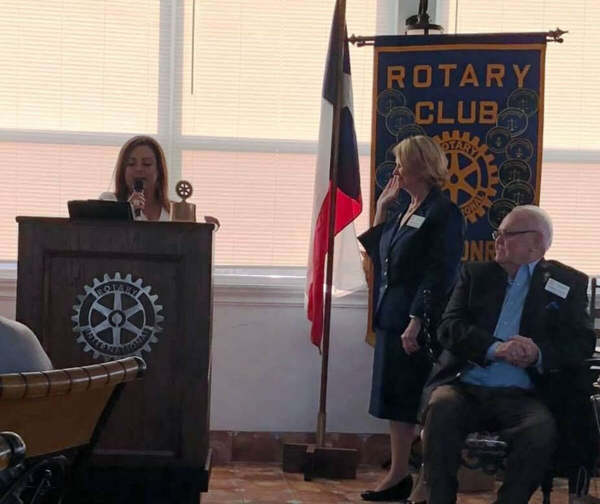 Doris Lockey, incoming President of The Rotary Club of Lake Conroe, being installed by outgoing President Monica Bresofski, as Wally Lockey looks on.