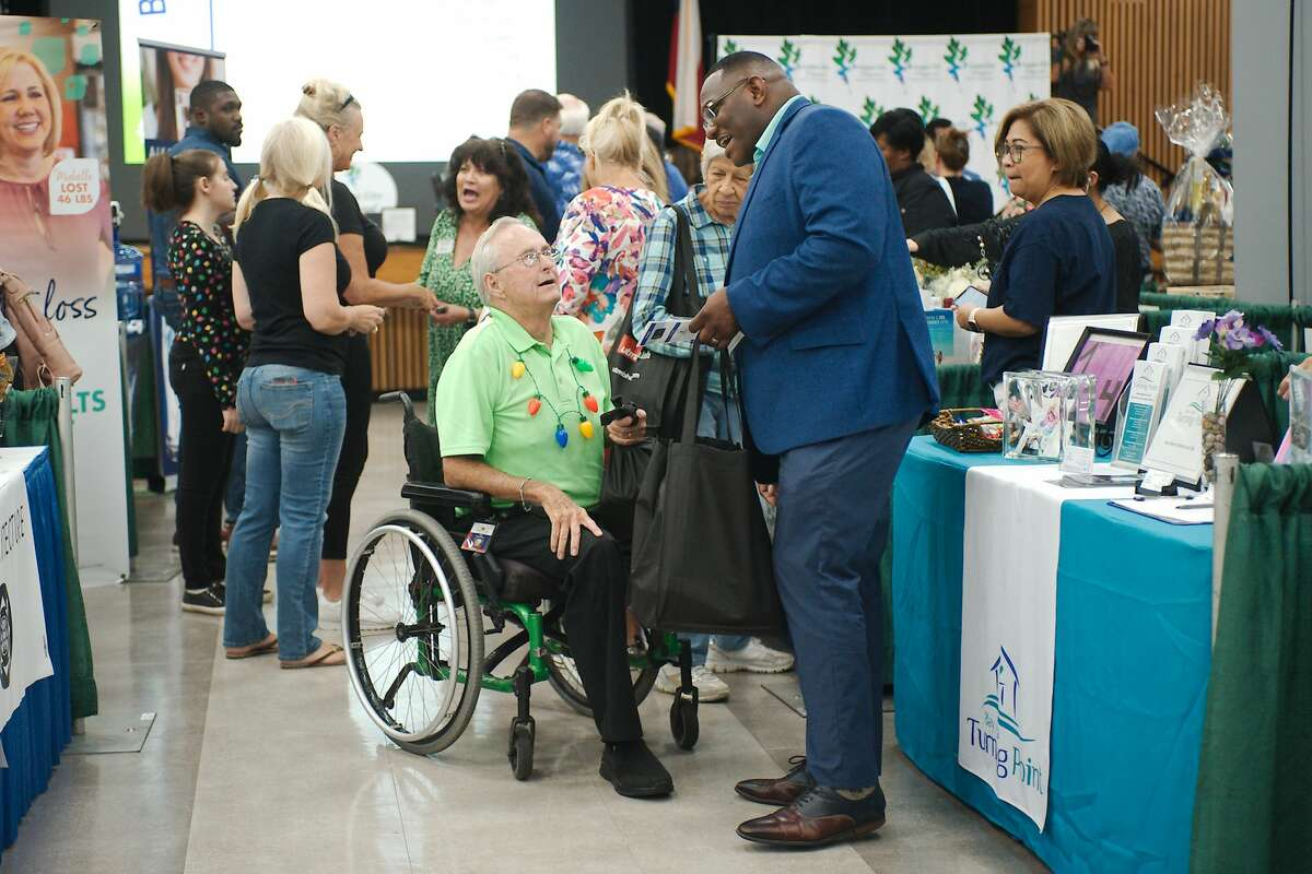 League City Mayor Pat Hallisey chats with Corey Allen during the expo.