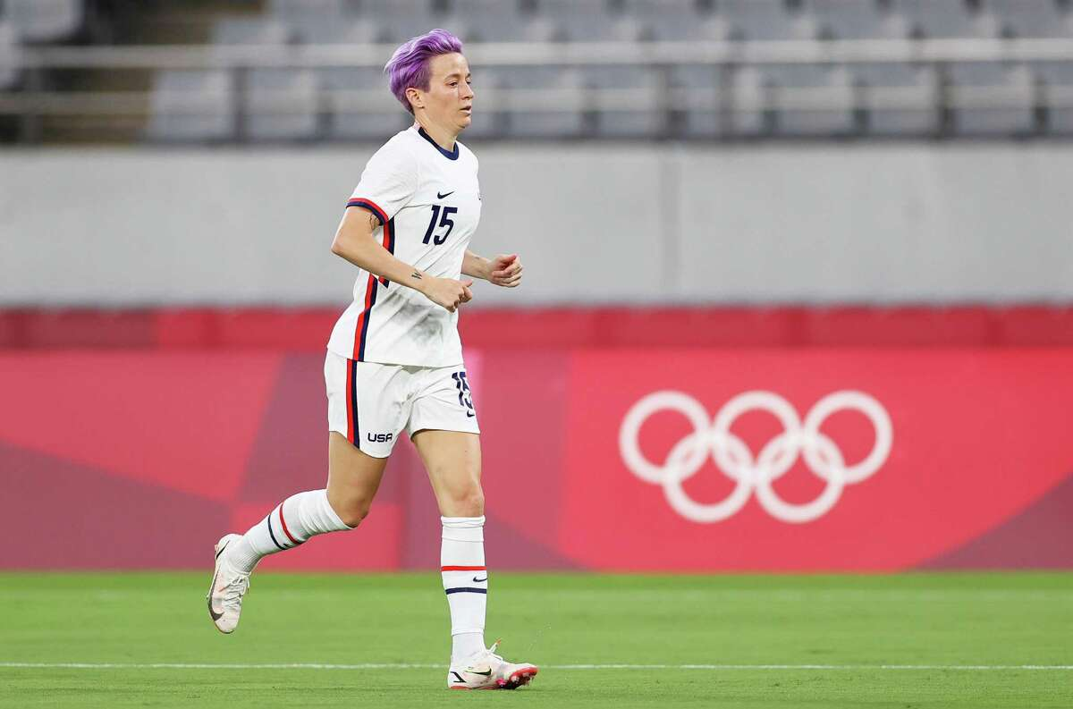 CHOFU, JAPAN - JULY 21: Megan Rapinoe #15 of Team United States looks on during the Women's First Round Group G match between Sweden and United States during the Tokyo 2020 Olympic Games at Tokyo Stadium on July 21, 2021 in Chofu, Tokyo, Japan. (Photo by Dan Mullan/Getty Images)