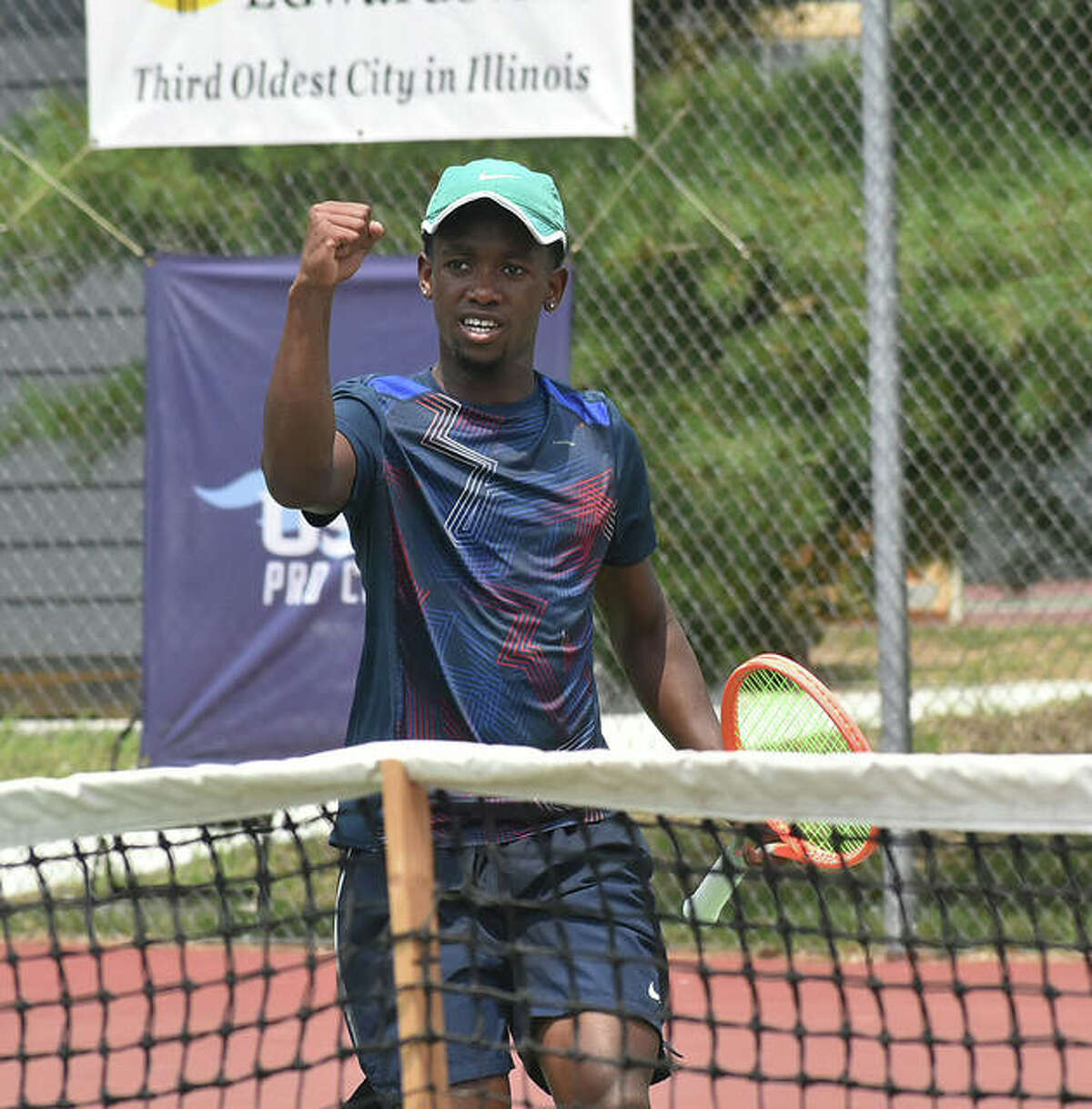 Siphos Montsi pumps his fist in celebration after breaking serve and taking the first game of the third set against Paul Jubb in the second round on Thursday in the Edwardsville Futures tennis tournament.