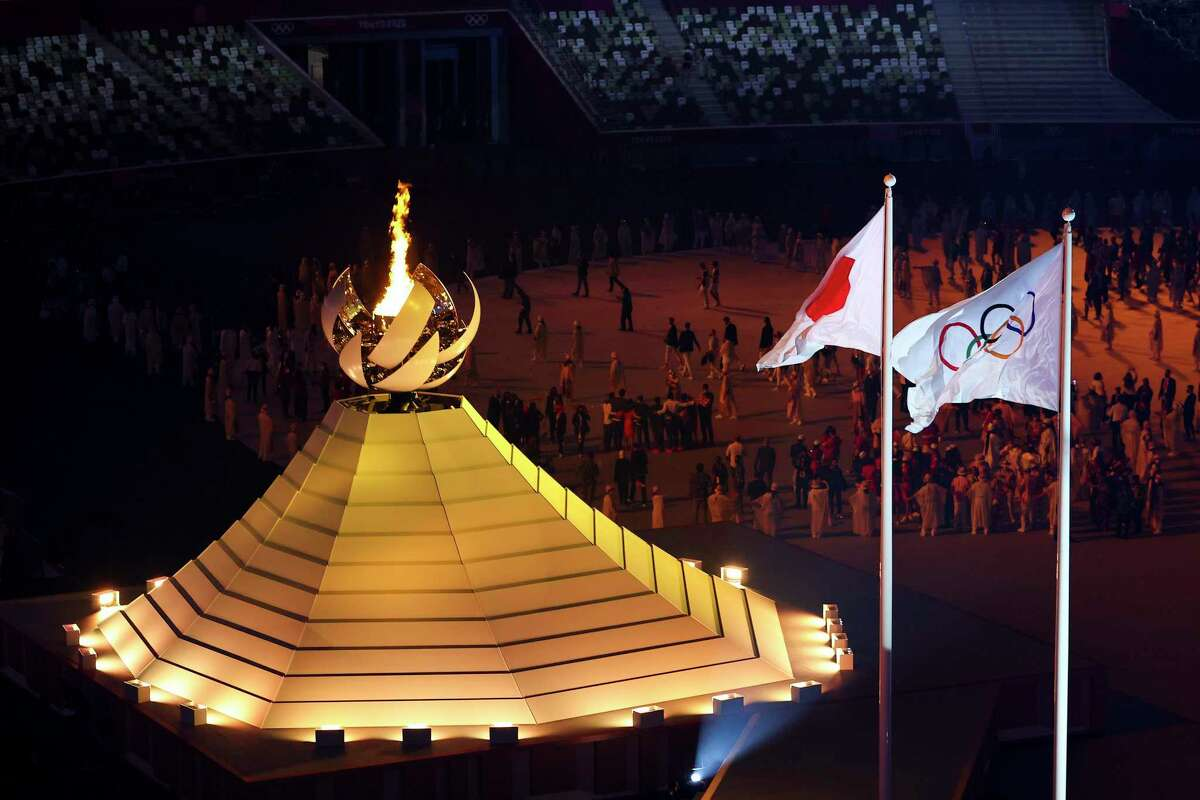 The Olympic Flame is seen during the Opening Ceremony of the Tokyo 2020 Olympic Games at Olympic Stadium on July 23, 2021 in Tokyo, Japan.
