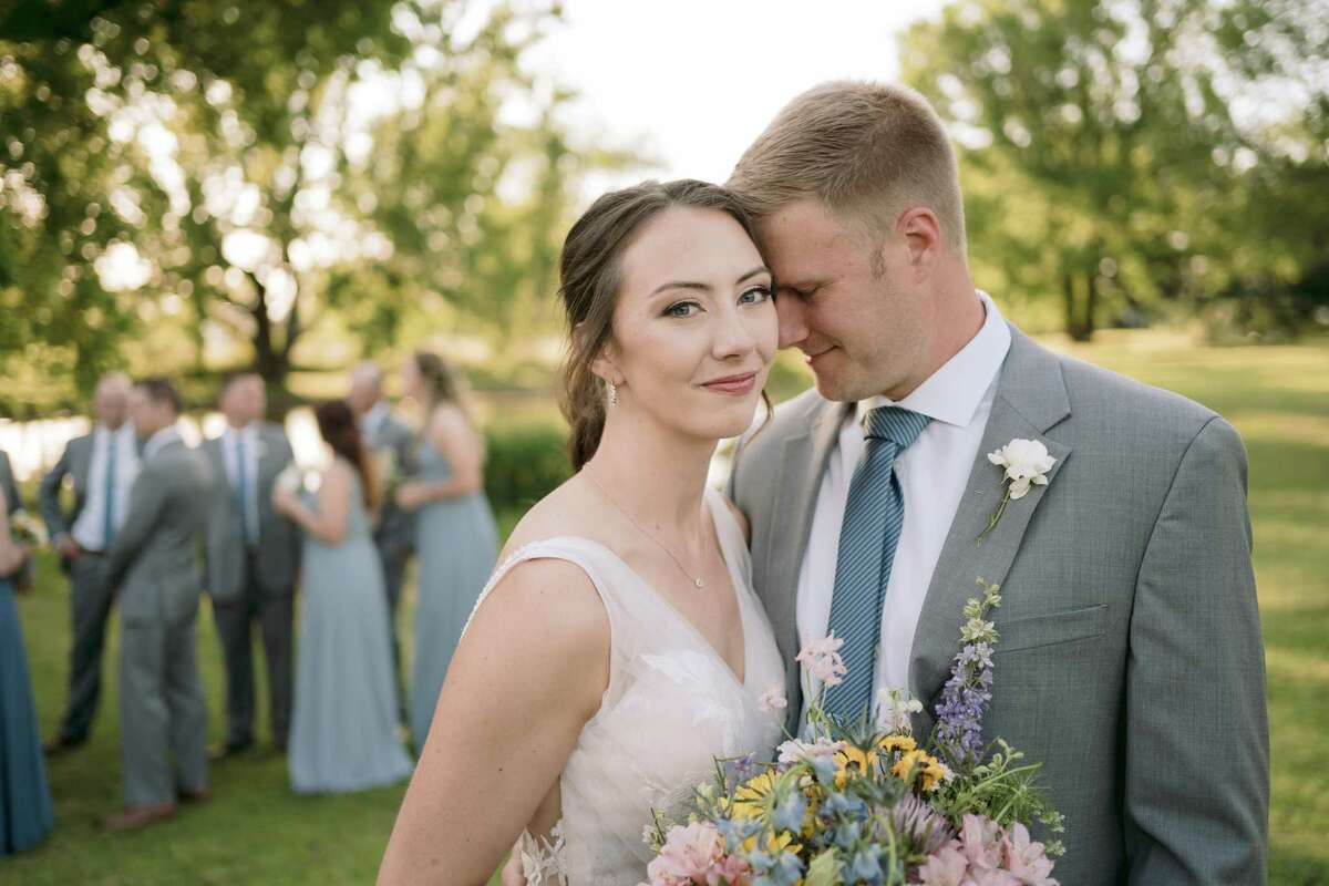 Brian, an assistant coach at UH, and Molly Gerwig were married May 15 in Arkansas. Two days before the wedding, they received Molly's cancer diagnosis.