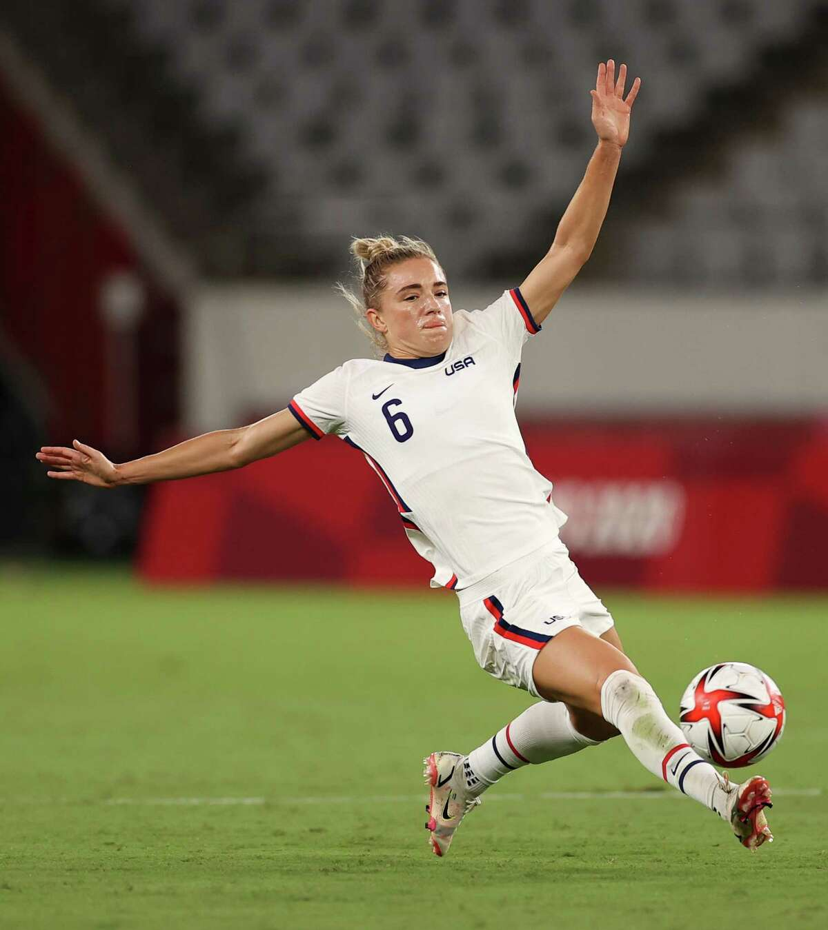 CHOFU, JAPAN - JULY 21: Kristie Mewis #6 of Team United States stretches for the ball during the Women's First Round Group G match between Sweden and United States during the Tokyo 2020 Olympic Games at Tokyo Stadium on July 21, 2021 in Chofu, Tokyo, Japan.