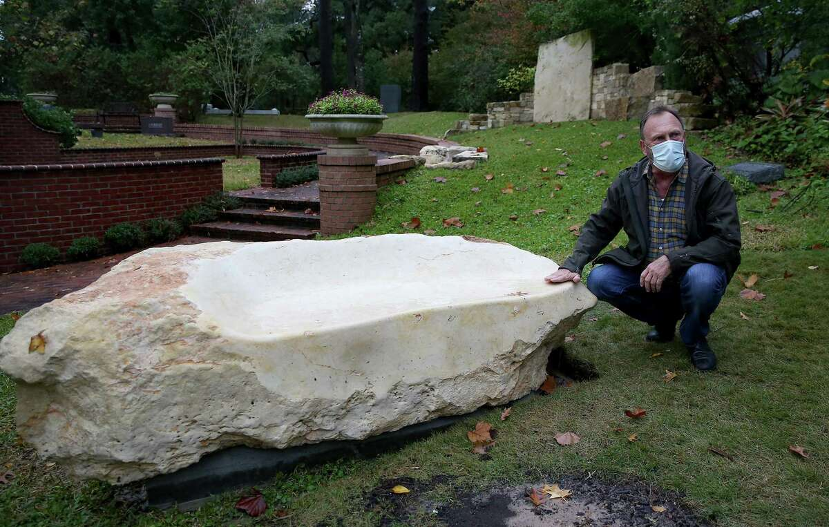 Landscape architect Johnny Steele talks about a bench on a family plot made from a piece of stone at Glenwood Cemetery in Houston on Saturday, Dec. 19, 2020.