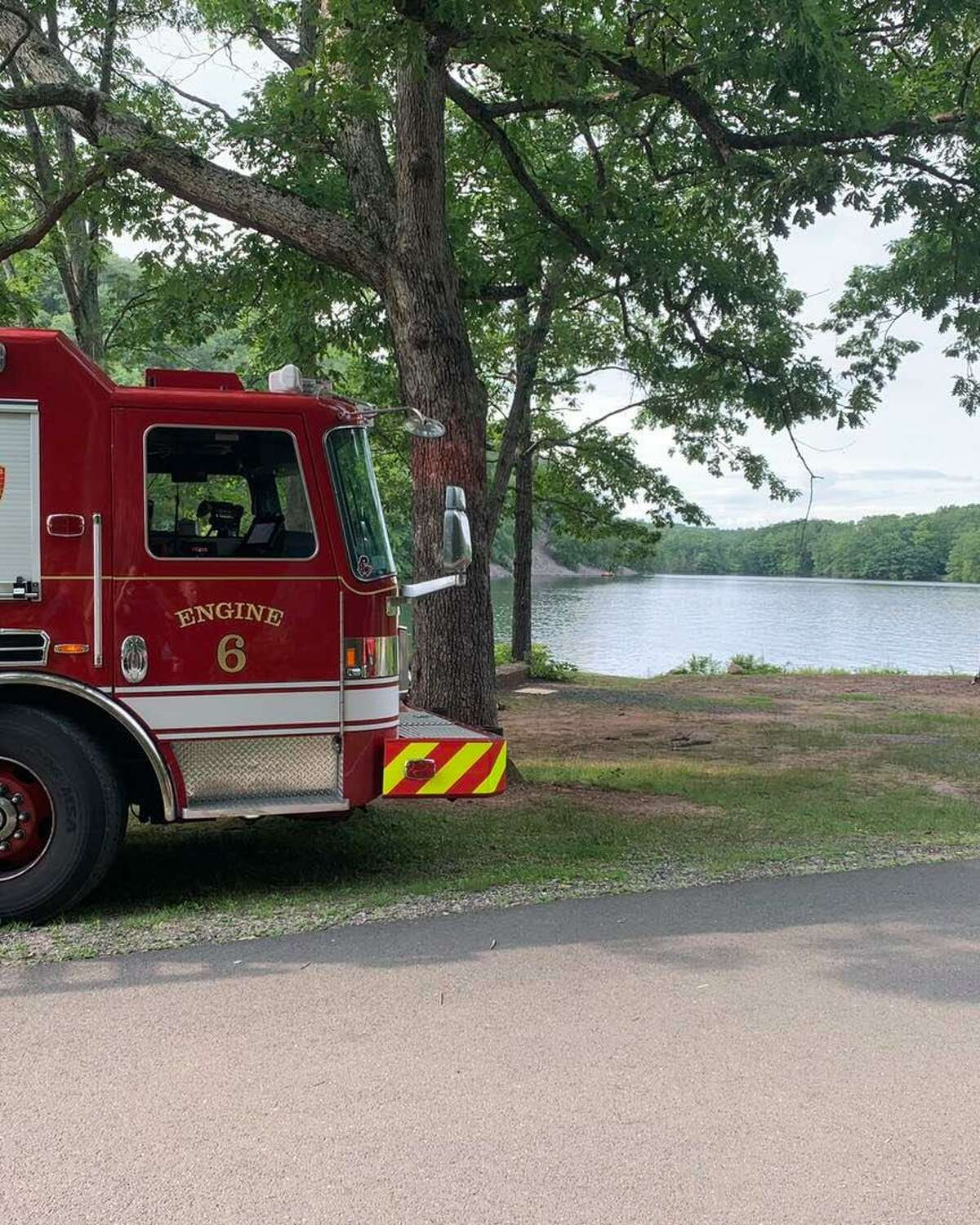 Crews at the reservoir in West Hartford, Conn., helping a lost hiker on Thursday, July 22, 2021.