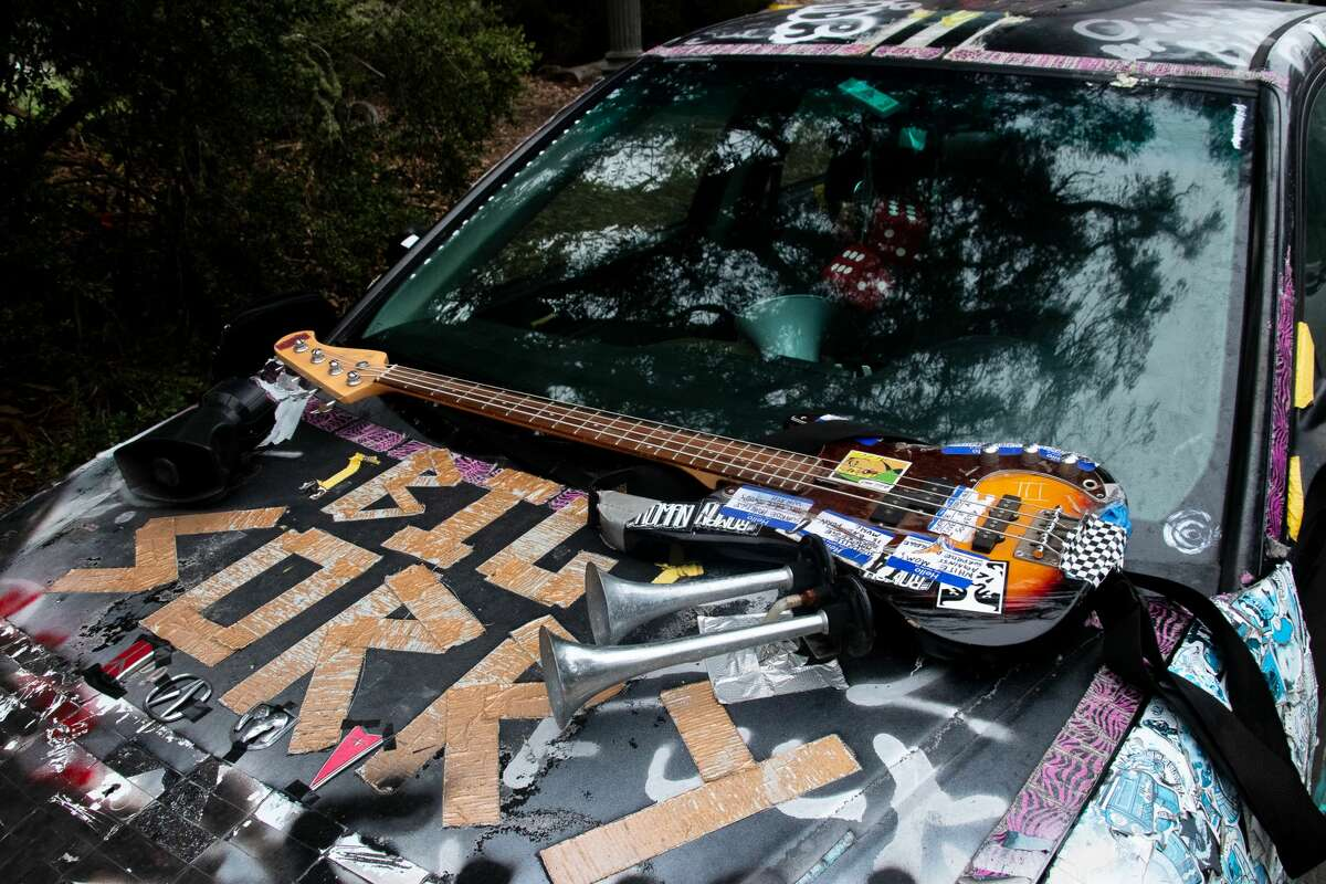 A guitar rests on the Surprise Privilege car in Golden Gate Park on July 18, 2021.
