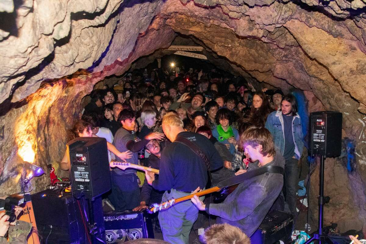 Decline and the crowd as seen from the back of the cave on July 16, 2021.