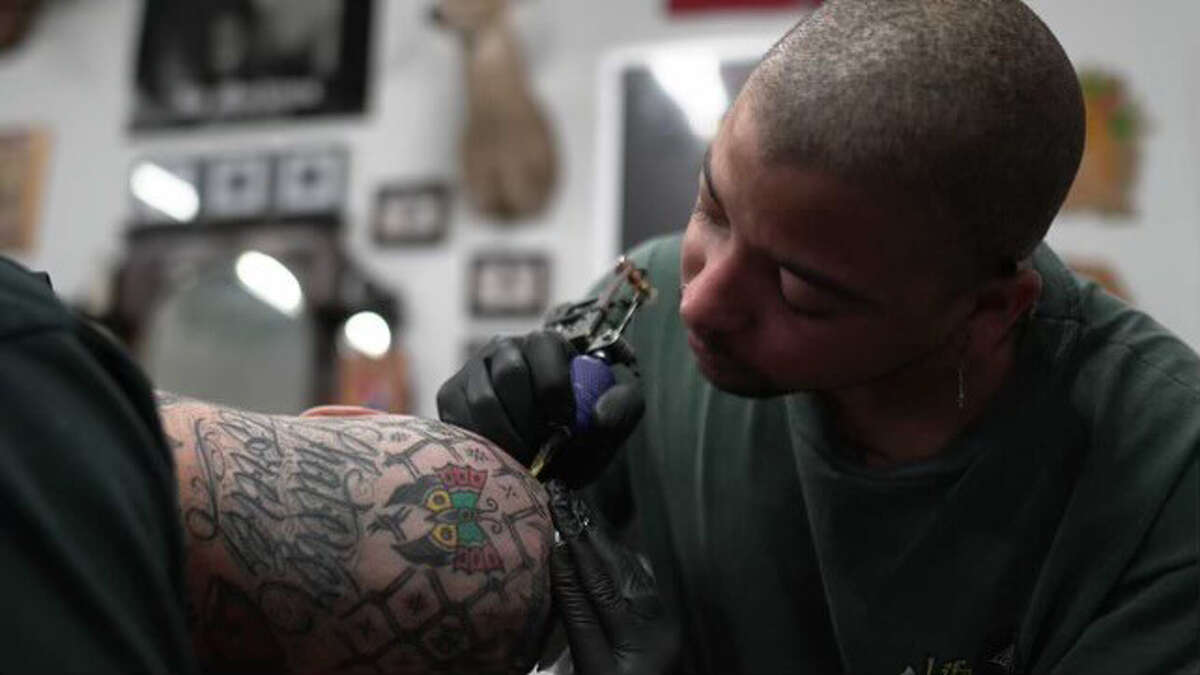 Julian Issac working as a tattoo artist at Red Eye Gallery, 804 William St., in Houston. He was found dead in June.