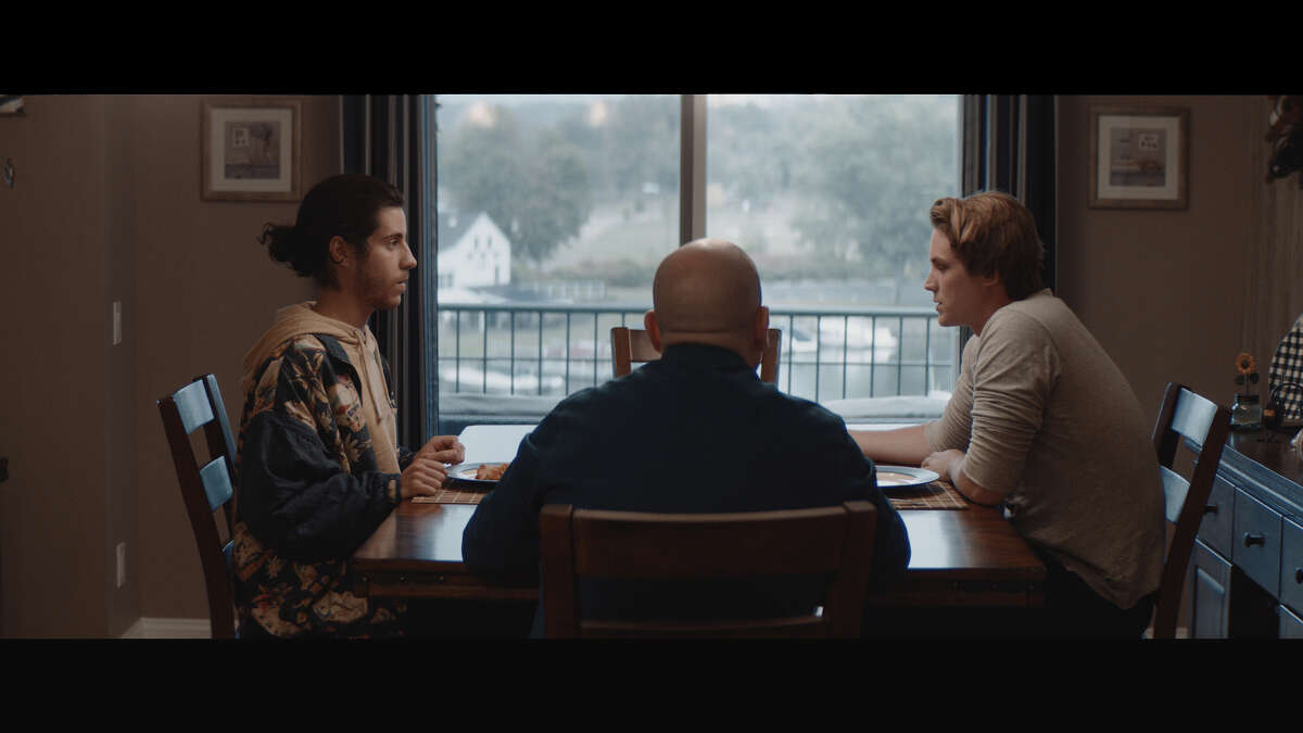 """Short horror film """"Family History"""" was co-produced by Danbury, Conn. resident Tom Ciubaand filmed at his CandlewoodLake home in October 2019. A scene from the film depicts lead characters Evan (left) and Sam (right) who visit Sam's father (center) on the anniversary of his mother's death."""