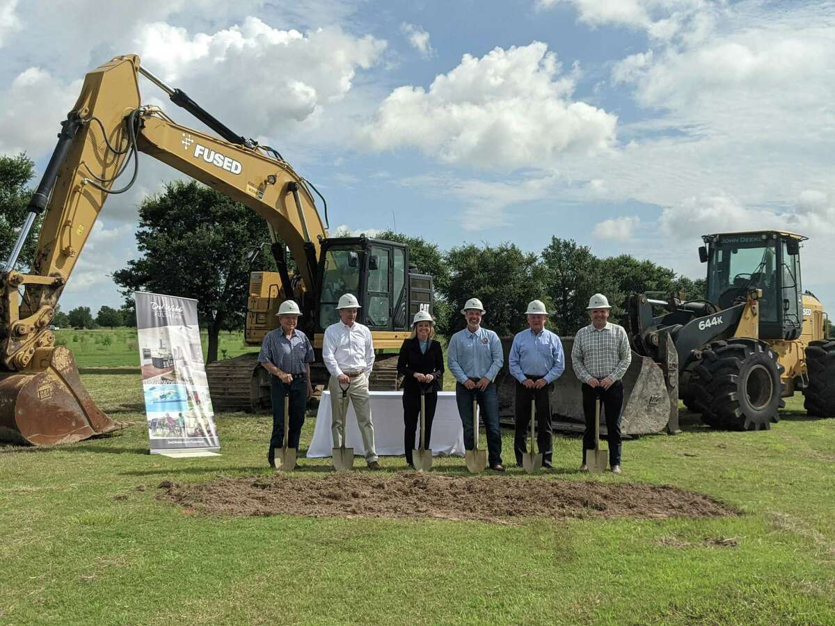 Pictured from left are Lou Waters, who sold the land for the new Del Webb Fulshear property; Lee Jones, vice president of land acquisition at PulteGroup; Lindy Oliva, division president at PulteGroup; Fulshear Mayor Aaron Groff; Patrick Duggan, vice president of land development at PulteGroup; and Jason Kelly, LJA Engineering.