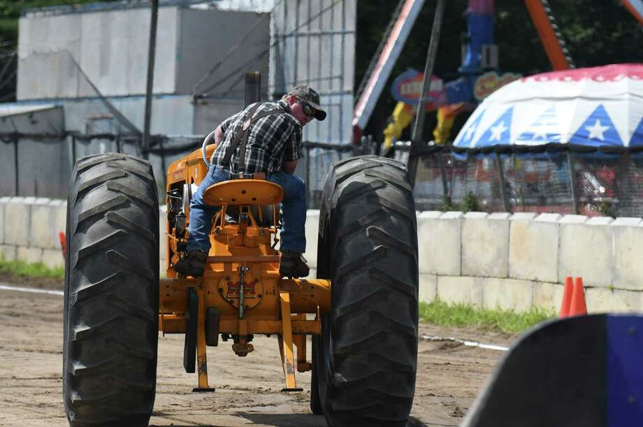 A tractor pull competitor backs up to the sled during the Saratoga County Fair on Friday, July 23, 2021, in Ballston Spa, N.Y. Photo: Will Waldron, Times Union / 20051664A