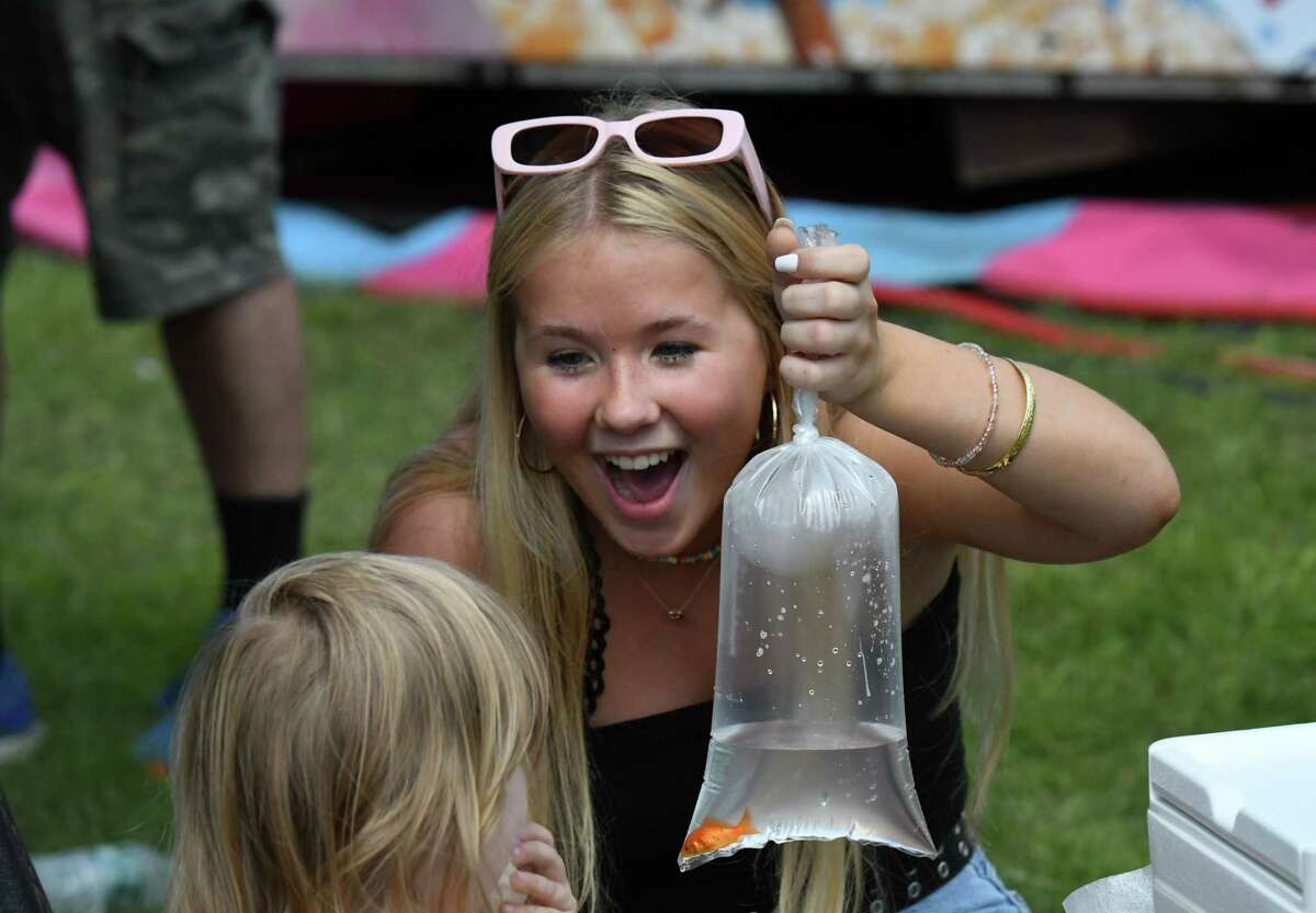 Sydney Swedish of Waterford proudly holds up the goldfish she won at the Saratoga County Fair on Friday, July 23, 2021, at Saratoga County Fairgrounds in Ballston Spa, N.Y.