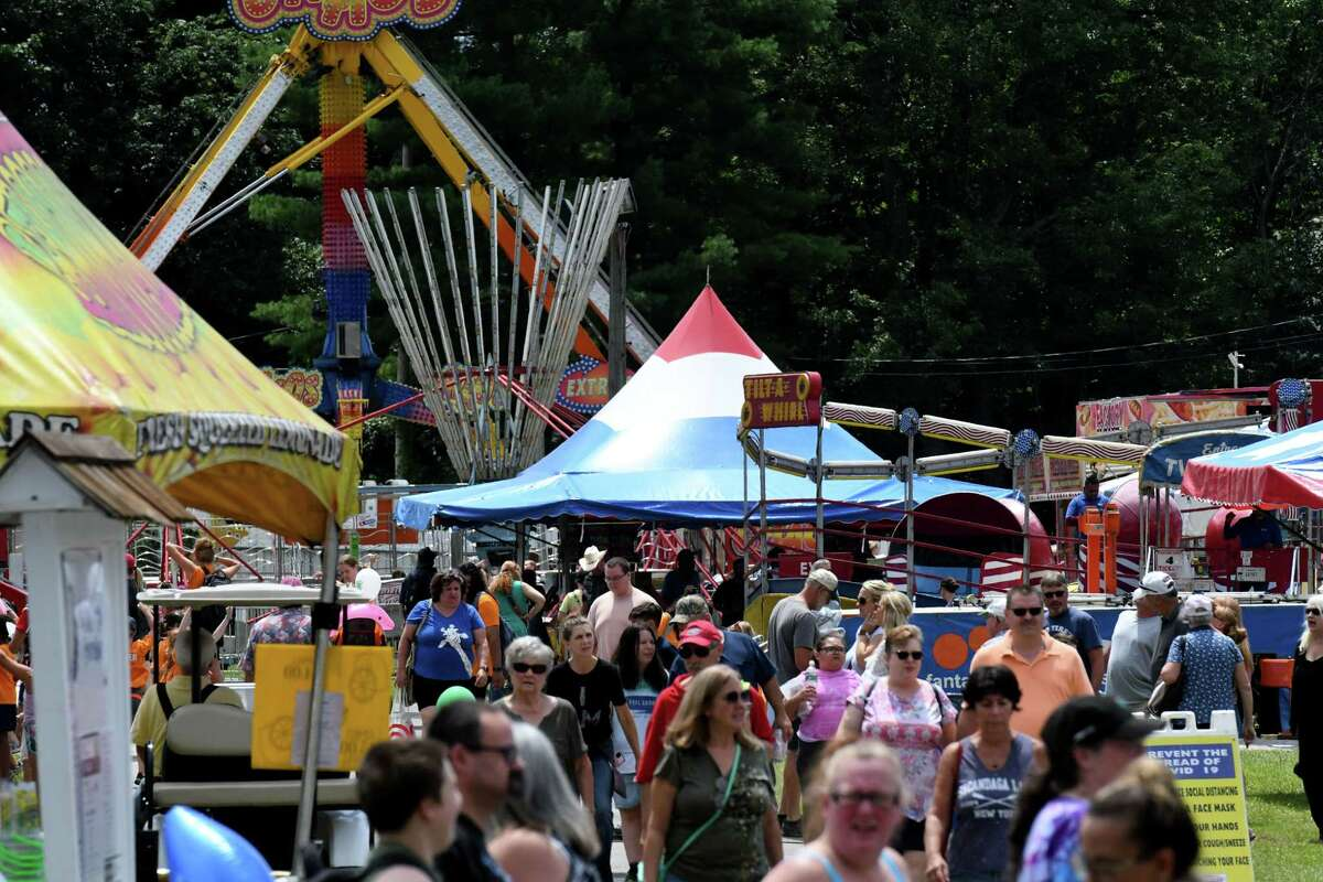 Saratoga County Fair visitors fill the fairway on Friday, July 23, 2021, at Saratoga County Fairgrounds in Ballston Spa, N.Y.