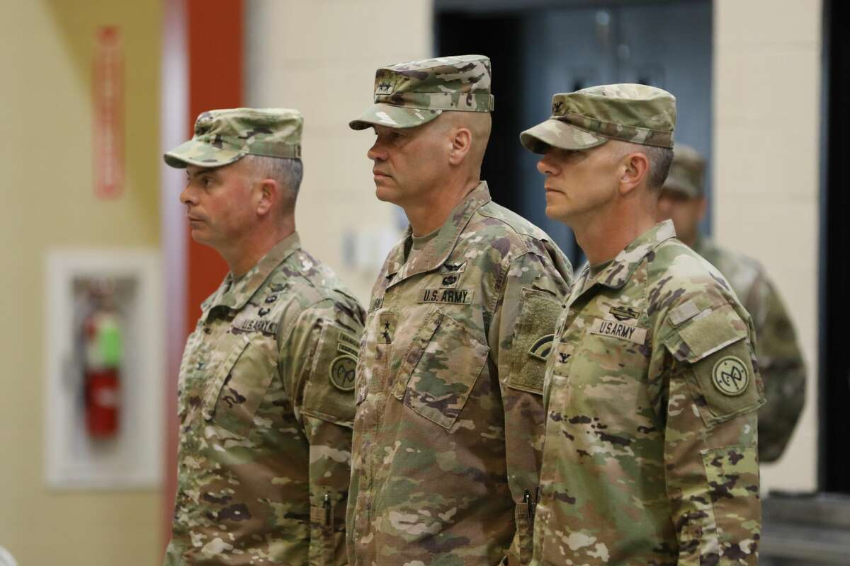 Col. Robert Charlesworth, from left, Maj. Gen. Thomas Spencer and Col. Sean Flynn, new commander of the 27th Infantry Brigade Combat Team, area ready to welcome soldiers at a ceremony at Fort Drum.