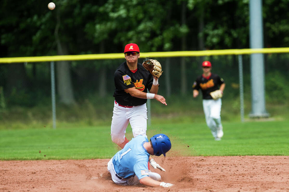 Berryhill's Logan McCoy throws to first base after tagging out a runner at second during a game against Petoskey Friday, July 23 2021 at Northwood University. (Katy Kildee/kkildee@mdn.net)