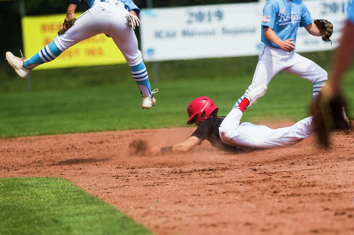 Berryhill's Al Money slides into second base during a game against Petoskey Friday, July 23 2021 at Northwood University. (Katy Kildee/kkildee@mdn.net)
