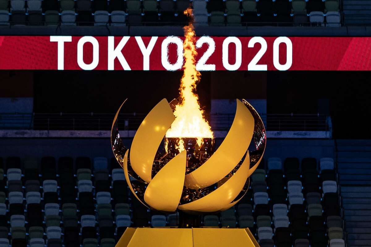 24 July 2021, Japan, Tokio: Olympia: Opening ceremony in the Olympic Stadium. The Olympic fire is burning. Photo: Swen Pförtner/dpa (Photo by Swen Pförtner/dpa/picture alliance via Getty Images)