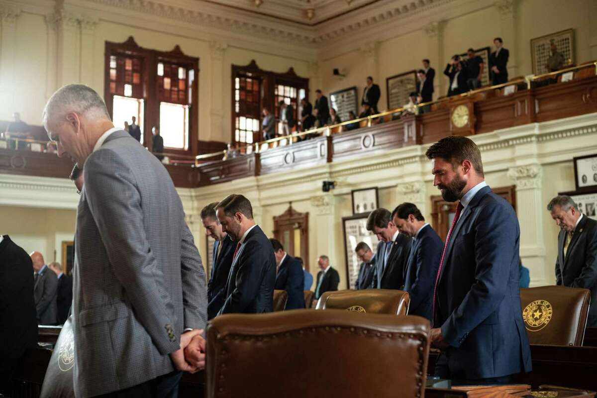 Texas state representatives bow their heads in prayer in the House chamber during an invocation at the start of this far-from-special session. Once again, lawmakers are looking to limit what history social studies teachers can share with students. It's absurd.
