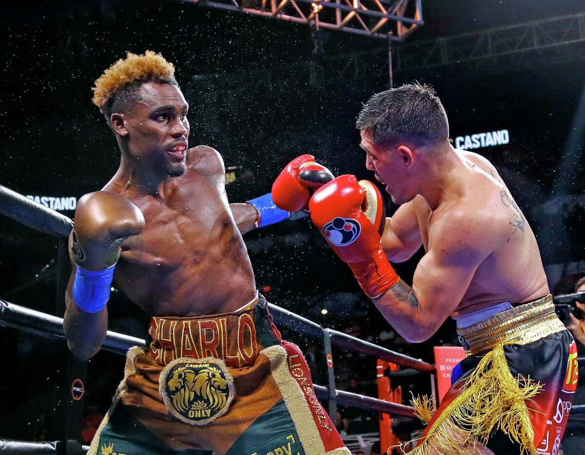 Jermell Charlo,L, throws a right at Brian Castano in their undisputed championship at 154 pounds in a Premier Boxing Champions on Saturday, July 17, 2021 at the AT&T Center. The fight was a draw.