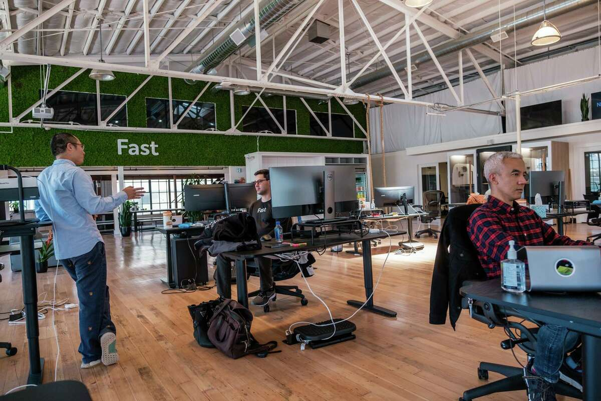 Ming Chang and Gabe Cohen are seen chatting at the Fast office space in San Francisco. The company announced Tuesday that it added a base of operations in Tampa, Fla.