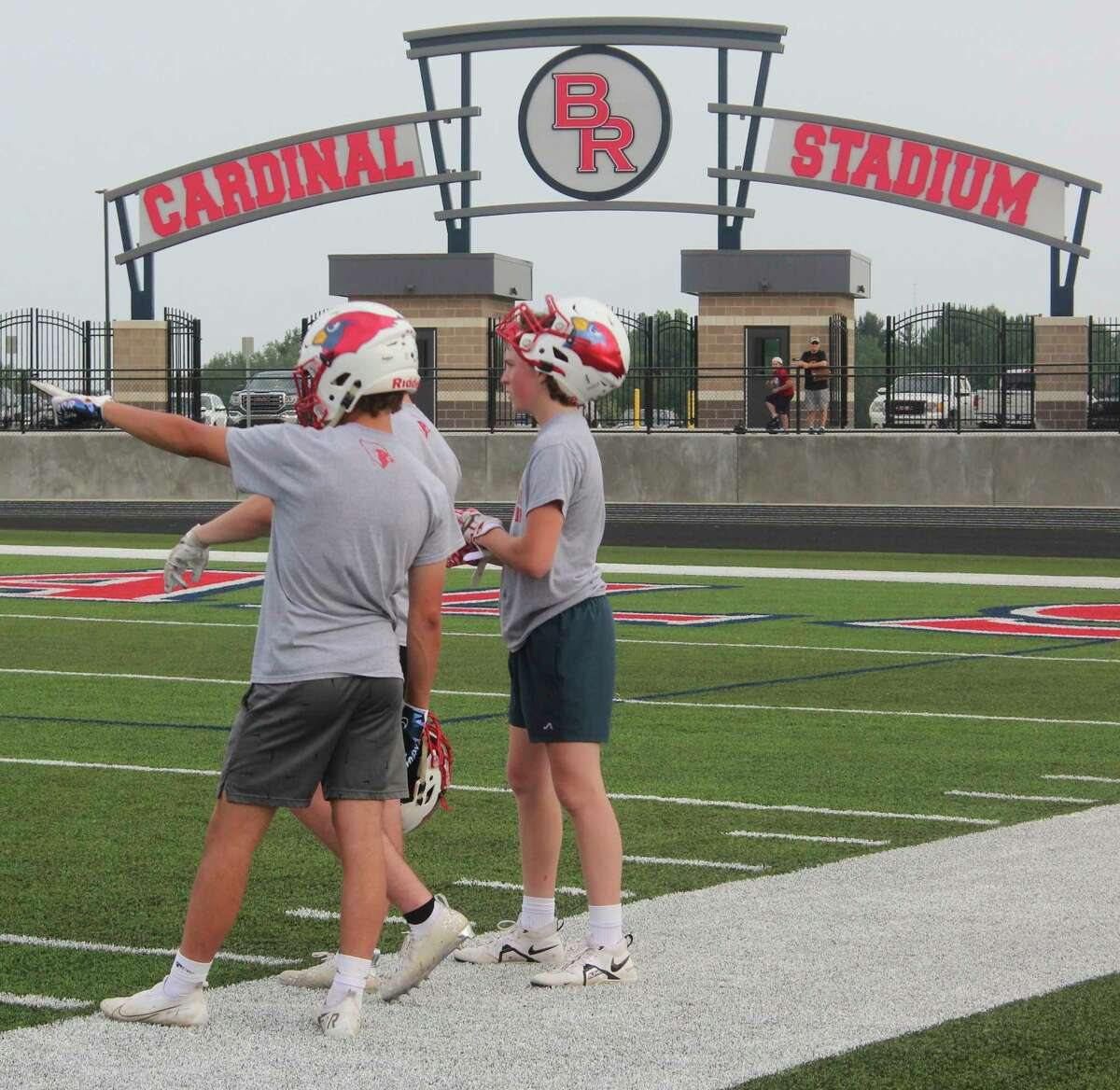 New turf, same team: With the recent completion of Cardinal Stadium, the Big Rapids football team now has the ability to train on a brand new terrain all its own. (Pioneer photo/Joe Judd)
