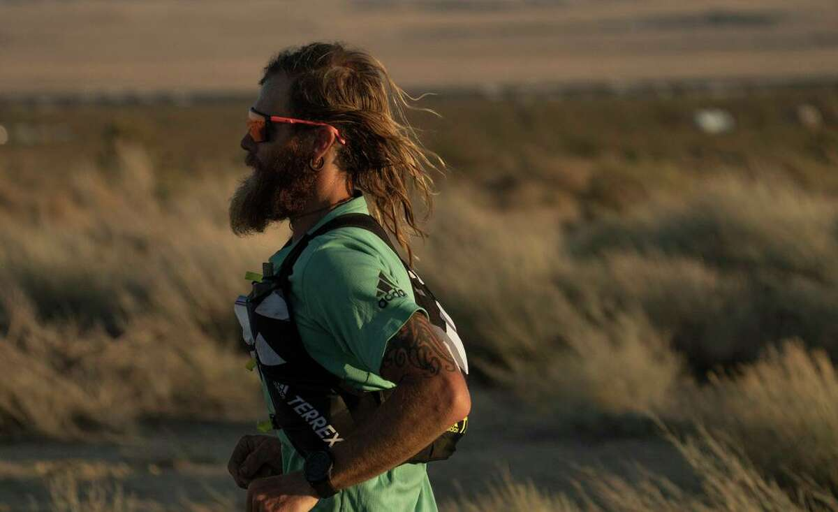Timothy Olson, 37, claims to have covered the wilderness path stretching from the Mexican border to Canada in 51 days, 16 hours and 55 minutes.