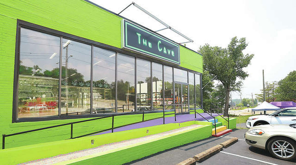 The bright green exterior of The Cave is hard to miss. The store will be open seven days a week, 9 a.m. to midnight.