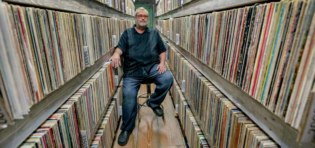 Steve Anderson, owner of Stevie Ray Vinyl online record store, in his custom records warehouse at his Lakehills home. Anderson owns more than 100,000 records and is selling his business due to health reasons.
