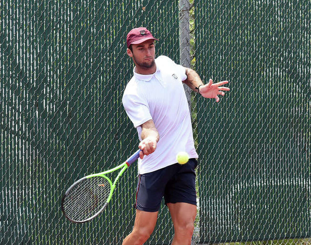 Christian Langmo hits a return shot during his doubles match on Friday inside the EHS Tennis Center.