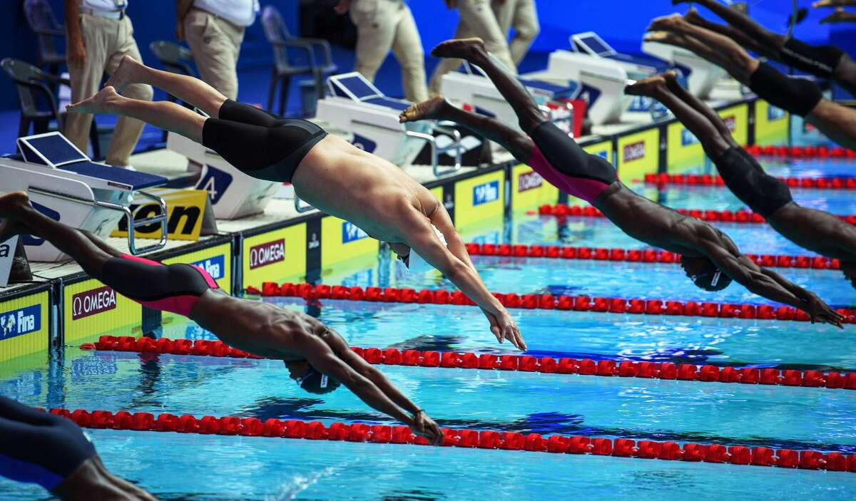 Shawn Dingilius-Wallace (2nd L) of Palau competes in a men's 50m butterfly qualifier during the swimming competition at the 2019 World Championships at the Nambu University Municipal Aquatic Center in Gwangju, South Korea, July 21, 2019.