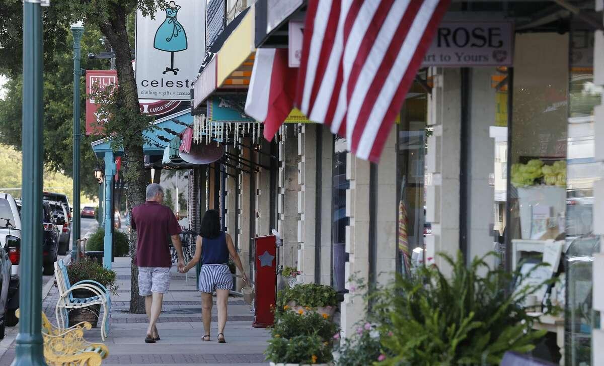 A couple walks through downtown Boerne.